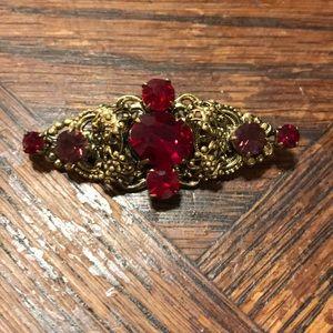 Red rhinestone bar style brooch